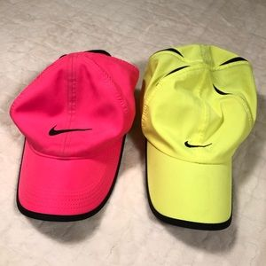 (2) nike featherlite baseball hats: pink & yellow